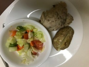 Pressure Cooker Chicken Thighs on plate with potato and salad