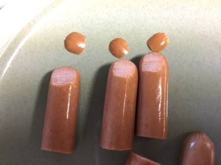 cutting tips of hotdogs