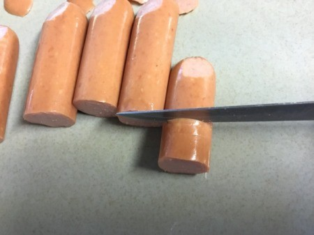 cutting hotdogs