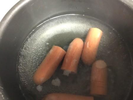 hotdog fingers cooking in pan
