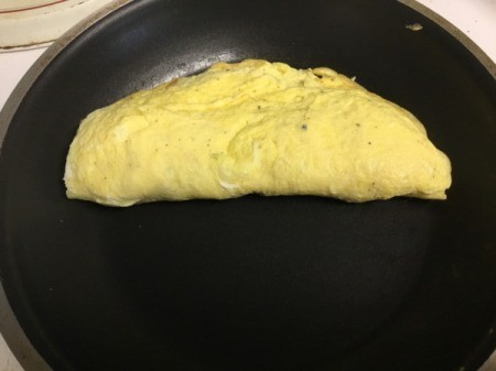 omelet cooking in pan
