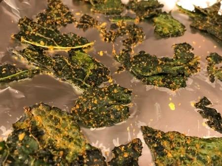 seasoned kale chips spread on sheet