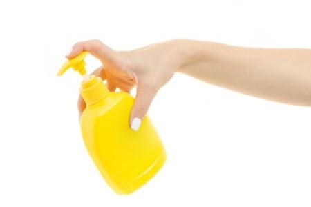 Woman Holding Pump Bottle