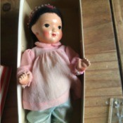 Identifying a Porcelain Doll - doll with painted face, in an old box