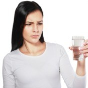 Woman Holding Smelly Glass of Water