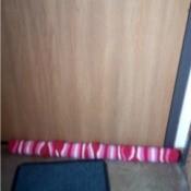 Christmas Draft Stopper - draft stopper at base of door