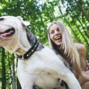 Girl with American Bulldog