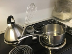 Built in Spoon Rest - wire whisk handle in the hanging hole on a pot handle