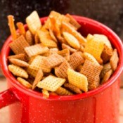Chex party mix in a red cup.