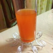 Decorative Recycled Drinking Glass Stand - stand turned upside down balanced on the curled fasteners