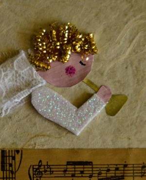 Angel Blowing On Trumpet Christmas Card - add cut pieces from the scrubber as hair and pens to make eye and pink cheek