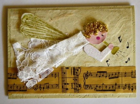 Angel Blowing On Trumpet Christmas Card - add musical notes with the black pen