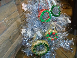 Miniature Wreaths - wreaths and silver snowflakes on silver tree