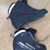 A pair of cross country ski boots in need of cleaning.