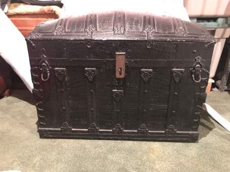 Value of Vintage Black Humpback Steamer Trunk - frontal view of a steamer trunk