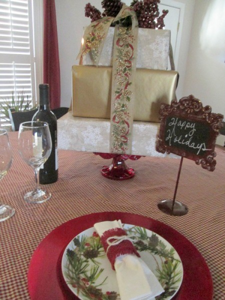 Recycled Boxes as Festive Centerpieces - holiday stack with greetings and wine