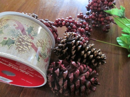Recycled Boxes as Festive Centerpieces - ribbon and pinecones