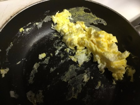 egg cooking in pan