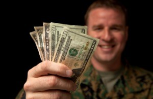 Military Serviceperson Holding Cash