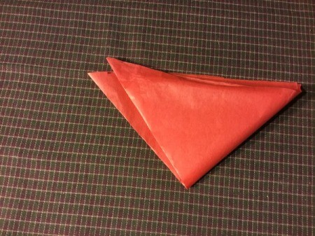 Thrifty Holiday Gift Wrapping - fold diagonally into a triangle and then again