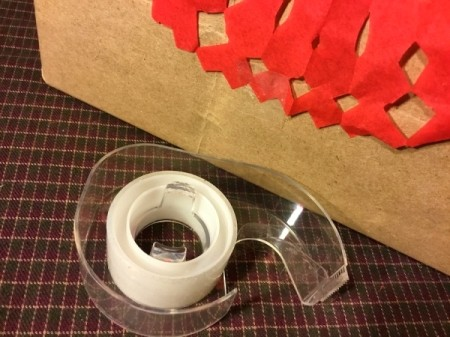 Thrifty Holiday Gift Wrapping - tape to top of wrapped package