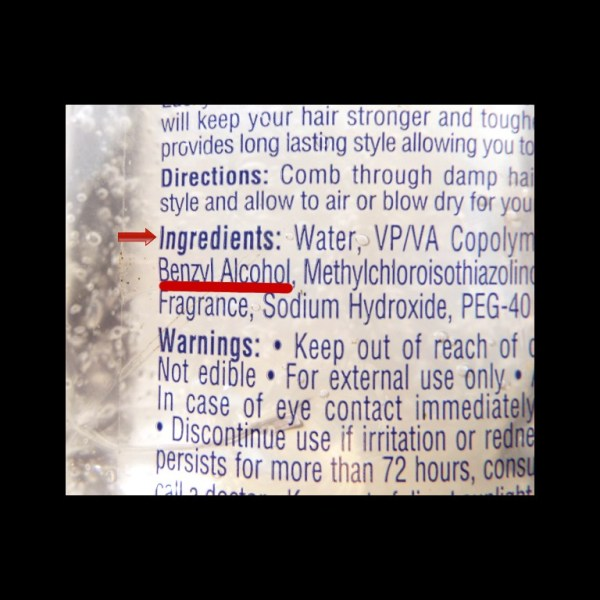 The ingredients on a bottle of styling gel containing benzyl alcohol