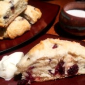 Cranberry Eggnog Scone on plate with clotted cream