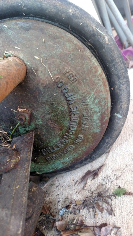 Value of an Old Reel Mower - text casting on inside of wheel