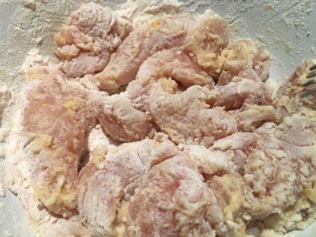 floured, marinated chicken pieces