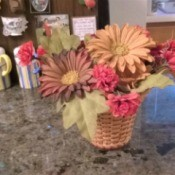 A wicker lampshade being used as a vase.