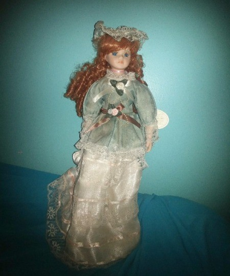 Value of a Knightsbridge Collection Porcelain Doll - red haired doll