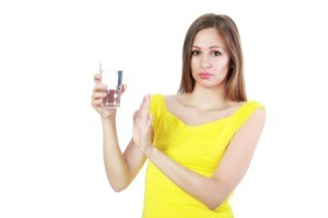 Woman Holding Glass of Smelly Water