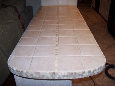 A tiled island counter.