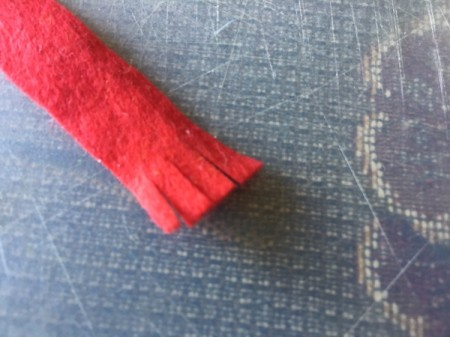 Upcycled Light Bulb Penguin - make red felt frayed scarf