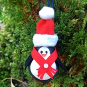 Upcycled Light Bulb Penguin - ornament hanging on tree