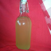 A bottle of homemade Miracle Orange Oil Cleaner.