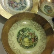 Determining the Value of China Plates - gold trimmed china plates with painted people in center