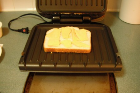 buttered bread with cheese on grill