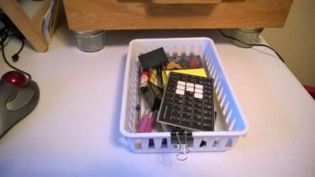 A basket that can slide underneath a storage drawer.