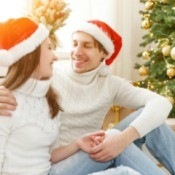 Boyfriend and Girlfriend sitting in front of Christmas tree