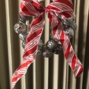 Christmas Ornaments Wreath - finished wreath with candy cane striped ribbon and silver ornaments hanging
