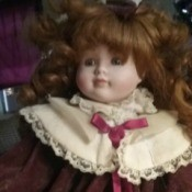 Value of a Samantha Porcelain Doll - red haired doll in velvet and lace dress