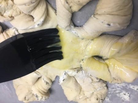 brushing dough with egg