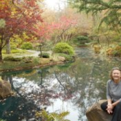 Fall Colorfest (Gibbs Garden, GA) - A woman seated by a pond with fall color.