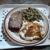 meatloaf, mashed potatoes, green beans on plate