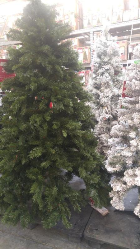 An artificial Christmas tree in a store.