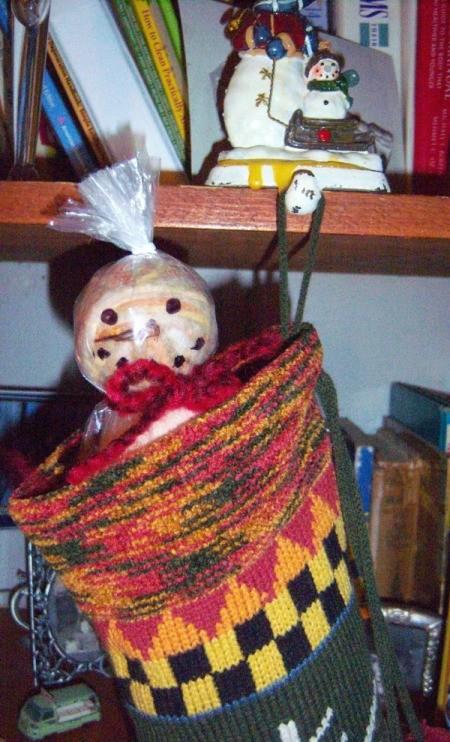 Dryer Ball Snowman Stocking Stuffer - snowman's head peeking out of stocking