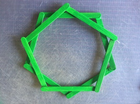 Popsicle Stick Wreath - glue a second pentagon on top of the first - turned slightly
