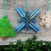 Pasta Christmas Ornaments - ornaments against a wood background