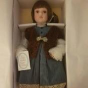 Value of Porcelain Jenny Doll - doll wearing blue dress and vest